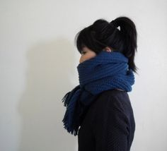 A big scarf in bright blue.
