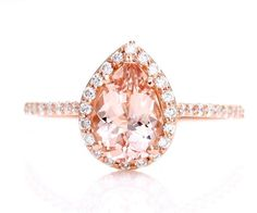 Love this tear drop morganite ring with surrounding diamonds and rose gold