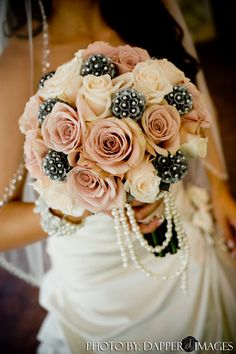 Don't like the gray things but the roses with the strand of pearls is pretty