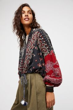 Paisley Pattern Bomber Jacket   Boho-inspired bomber style jacket pieced with different patterns and colors in an oversized silhouette.  * Striped rib trim * Dolman style sleeves * Zip front closure * Drawstring waistband