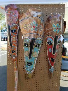 Original painted palm frond masks by Leslie Flynn
