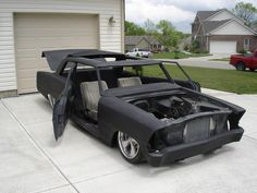 bagged Chevy II Nova suicide doors and bodydropped