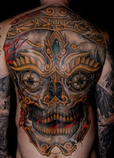 Modern-day tattoo culture has popularized Tibetan skull tattoos because they signify the fleeting reality of the human form while acknowledging the importance of connecting to others in positive ways while we take part in this life. Skull Tattoo Design, Skull Design, Skull Tattoos, Back Piece Tattoo, Pieces Tattoo, Tibetan Tattoo, Unique Tattoos For Women, Feminine Symbols, Back Tattoos For Guys