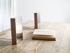A unique desktop speaker system for people who like nice things, crafted from solid alder and stainless steel.