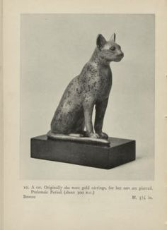 Ancient Egyptian animals a picture book, 1942. Metropolitan Museum of Art Publications. The Metropolitan Museum of Art, New York (b10395131)   Originally this cat was designed with earrings, but they have eroded over time. #cats