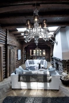 Scandinavian/Nordic Rustic Design - Wow, I love the sparkledy chandy with all the rustic wood!