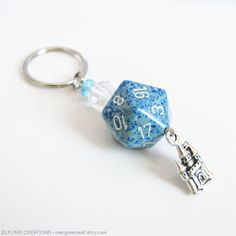 This blue and silver Dungeons and Dragons RPG gaming dice keychain was inspired by the tales where theres a castle or tower high in the sky amid