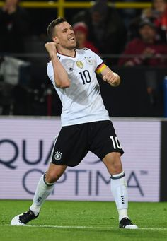 Germany's midfielder Lukas Podolski celebrates after scoring during a friendly football match between Germany and England on March 22, 2017 in Dortmund, western Germany. .It is Lukas Podolski's last match with the German team. / AFP PHOTO / PATRIK STOLLARZ
