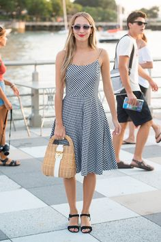 Gingham + wicker bag + a harbour = summer perfection. Well done Harley Viera Newton!