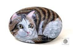 Cat hand painted on rock