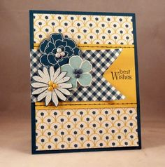 handmade card ... blue, yellow and white ... like the use of two patterned papers .... lovely flowers from Secret Garden on a fishtail banner ... good design ,,, Stampin' Up!