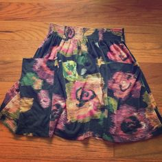Flower print flowy skirt 65% polyester 35% rayon eye candy skirt size medium. Gently worn but in very good condition, if anything the wear has only made it marginally softer than it originally was. Waistband is small/medium, the slightly longerlength is what makes it a medium. Two pockets on front of skirt Skirts