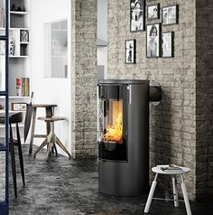 Rais Release Four More Clever Stoves! Danish stove maker Rais has released updated versions of their popular Viva 98 and Viva 120 wood burning stoves. They have introduced the Viva L 100 and Viva L 120 models, available in both the … Wood, Brick Wall Living Room, Glass Door, Fireplace Supplies, Stove, Freestanding Stove, Fireplace, Wood Burning Fireplace, Wood Burning Stove