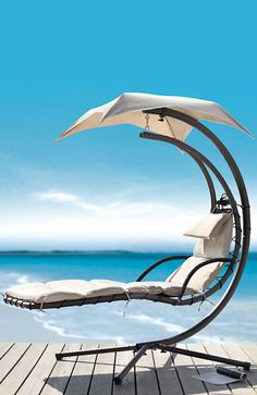 Outdoor swing lounge // with built-in umbrella... I'll have the beach, too! #furniture_design