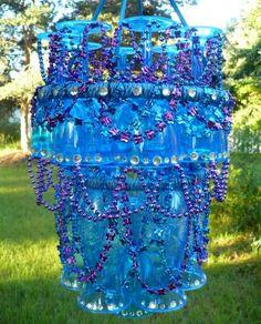 Plastic wine glasses, embroidery hoops, rope and rhinestones.  Looks pretty neat