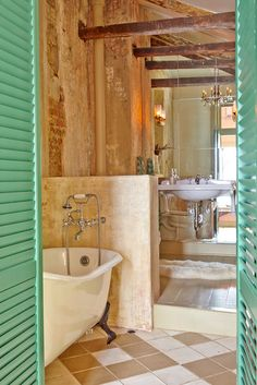 Eclectic Bathroom by Logan Killen Interiors-love the tub, and the floor tile pattern