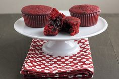 Chocolate-Stuffed Red Velvet Cupcakes are moist and tender on the outside and oozing with warm, rich chocolate inside. Easy yet impressive!