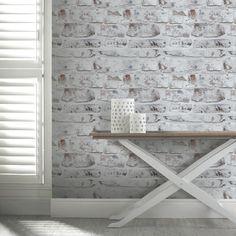 The Arthouse Opera White Washed Brick Wallpaper is perfect for creating the urban industrial trend or a shabby chic look, so ideal for use in any room.