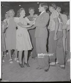 Judy Garland, young film star, and Bobby Jordan, one of the Dead End Kids, are pictured as they tried out for the Jitterbug Contest held in the American Legion Stadium.