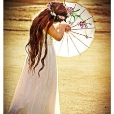 gorgeous Flower Girl & the parasols are always beautiful photo props on the beach