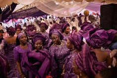 In Nigeria it's common to ask guests to wear color-coordinated outfits, called aso ebi, at social events, such as this wedding at the Yoruba Tennis Club in Lagos. [Photo by Robin Hammond]
