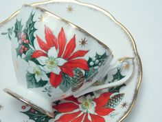 "Queen Anne Vintage Fine Bone China Tea Cup and Saucer Made in England ""Noel"" Poinsettia Pinecones Holly Berries Gold Stars Trim"