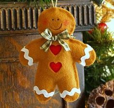 *FELT ART ~ Handmade Felt Gingerbread Man Christmas Decoration by thoughts of you Gingerbread Crafts, Gingerbread Decorations, Felt Christmas Decorations, Felt Christmas Ornaments, Christmas Gingerbread, Noel Christmas, Homemade Christmas, Glitter Ornaments, Handmade Ornaments