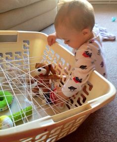 Spider's Web DISCOVERY BASKETS are a fun sensory activity which also builds dexterity & problem solving skills. All you need is a laundry basket, wool/string to make the web & fun household items/toys to put in the basket. Check out these other fun indoor activities for under 2's as well.