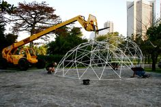 Building a dome frame with the help of an extending boom fork lift in Miami, FL.
