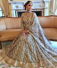 Gold sequins full sleeves reception lehenga. Click on picture to see lehenga price. #Frugal2Fab Indian Wedding Gowns, Indian Bridal Wear, Pakistani Wedding Dresses, Desi Wedding, Indian Dresses, Indian Outfits, Punjabi Wedding, Pakistani Bridal, Indian Attire