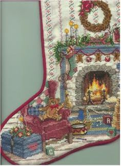 Intense counted cross stitch for a friend. This is a Christmas Stocking I made. The back is velvet with piping seams.