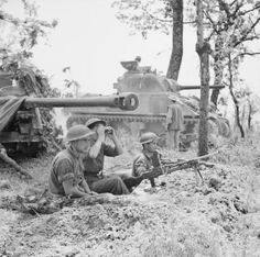 A British 17-pdr anti-tank gun and crew near Cassino, Italy. 17 May 1944. A Sherman tank can be seen in the background.