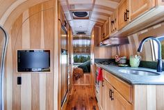 Another Beautiful Airstream Renovation by Orvis The updated cabin is appointed with natural hickory wood, aged oak flooring, copper sheet, and genuine leather. Brand-new running gear was installed below including a new axle, brakes, suspension, wheels, tires, and coupler.