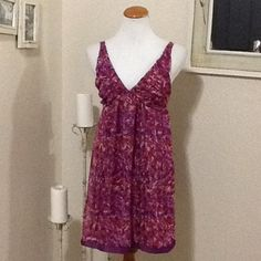 """fuchsia print mini dress Abstract print mini dress. Deep front V, elastic panel on back, pull over style. Stretch polyester slip with sheer overlay. Measures approx. 32"""" long from shoulder to hem, 16"""" across chest. johnny Martin Dresses Mini"""