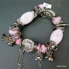 great colors w pink white and pewter and charms and bells!