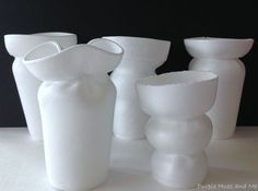 rubber bands around styrofoam cups dumped into HOT water = cool vases that hold water.