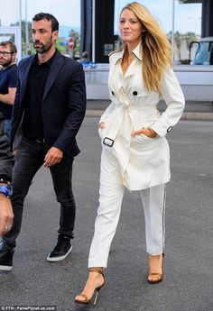 Effortless style: Paired with towering brown and gold stilettos, the 28-year-old star kept...