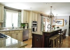 kitchen island raised bar | Kitchen idea-painted cabinets and bar island