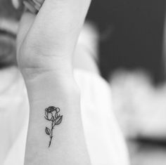 Tiny blackwork rose tattoo by Evan