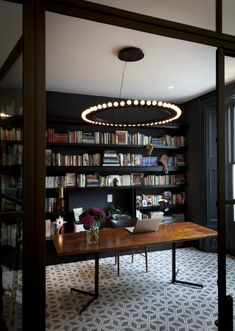 Cool stylish home office with a library 900x1265 Most Fashionable Home Offices for Cool Telecommuters