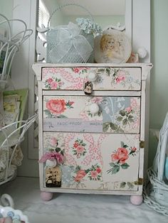 Chest covered in vintage wallpaper