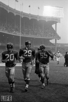 "Here, a series of recently discovered, previously unpublished photographs by LIFE photographer George Silk, featuring Roosevelt ""Rosey"" Grier and famous New York Giant teammates like Frank Gifford,. New York Giants Football, Sport Football, Football Players, School Football, Giants Players, Browns Football, Football Uniforms, Football Stuff, Baseball"