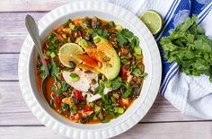 Paleo Chicken and Kale Tortilla Soup | Healthy Mexican Recipes | Homemade Recipes | https://homemaderecipes.com/14-healthy-mexican-recipes/