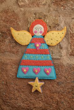 Angel from Appliqué Angels and Hearts by Madeleine Millington Embroidered Christmas Ornaments, Felt Ornaments, Christmas Angels, Christmas Crafts, Christmas Wall Hangings, Felt Christmas Decorations, Thanksgiving Decorations, Diy Angels, Xmas Stockings