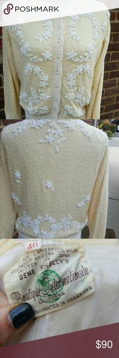 Vintage 50's beaded sweater 40 I have had this in storage for some time and it is a little bit snug on me. No moth damage and the only slight damage is shown in the photo. No low balls on this I know what this goes for on vintage sites. 18 inches shoulder to shoulder and approximately 20 under the arms. Vintage Sweaters Cardigans
