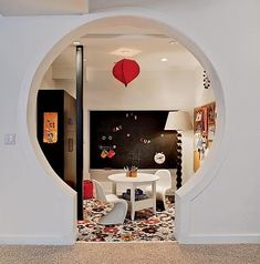 keyhole playroom... I love that doorway, it I ever get blessed to buy my own home, I just may have to steal this idea!