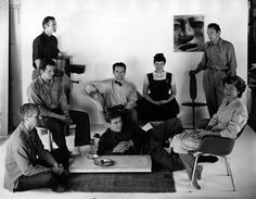Charles and Ray Eames sitting on their LA CHAISE with various staff members, circa in advance of MOMA's Low Cost Furniture competition Charles & Ray Eames, Ray Charles, Profession Of Faith, Artists And Models, Barbican, Galleries In London, Space Architecture, Modern Graphic Design, American