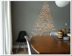 String Christmas lights on a wall in the shape of a Christmas tree! Creative Christmas Trees for Small Spaces Wall Christmas Tree, Creative Christmas Trees, Noel Christmas, Holiday Tree, Xmas Trees, Christmas Stockings, Christmas Tree Cat Proof, Christmas Crafts, Fake Trees