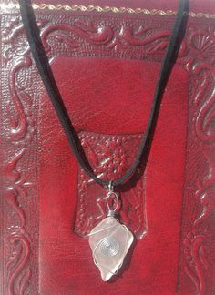 """This gorgeous sea glass necklace is handmade using sea glass found on the Scilly Island beaches and waxed leather cord. The sea glass pendant is attached to a black waxed leather cord that's 20"""" in length.   eBay!"""