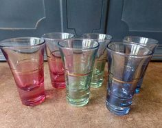 Vintage Set of 6 Shot Glasses, Bar Ware, Tinted, Gold Trim, Home Decor, Entertaining, Hostess Set, House Warming, Collectible Set of 6 Vintage Shot Glasses 2 of each color Red, Green, Blue Flared rim Gold Trim 3 tall x 2 mouth Good vintage condition, no chips or scratches